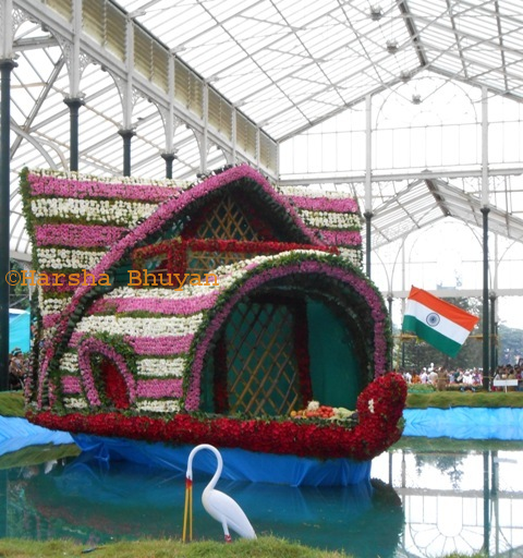 A boat made of Flowers and National Flag